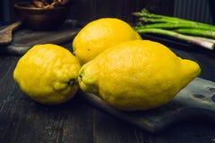 Strange lemons on wooden board Stock Images
