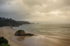 Strange lighting over Tenby Beach, incoming rain Royalty Free Stock Photography