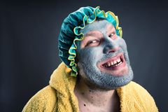 Strange man with face pack Royalty Free Stock Photo