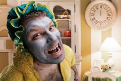 Strange man with face pack Royalty Free Stock Photos
