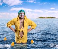 Strange man with face pack stands in water Royalty Free Stock Photography