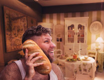 Strange man listening to something in bread Stock Image