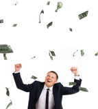 Strange man uder rain of dollars Stock Photo