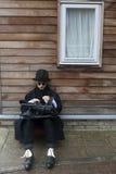 Strange man wearing black coat Royalty Free Stock Image