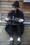 Strange man wearing black coat Stock Photos