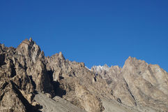 Strange mountains and blue sky  in Northern  Pakistan Stock Images