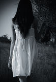 The strange mysterious girl in white dress royalty free stock photos