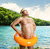 Strange naked man on the lake Royalty Free Stock Photo