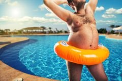 Strange naked man at the pool Royalty Free Stock Photo