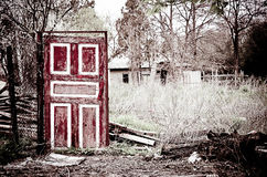 Strange old door standing among the remains royalty free stock photo