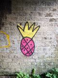 Strange pink and yellow spray painted graffiti logo on underpass. Wall; Essex; England; UK Stock Photos