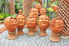 The strange pots sculpture look like human face in Nong Nooch tropical garden in Pattaya stock photos