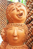 The strange pots sculpture look like human face in Nong Nooch tropical garden in Pattaya Stock Image
