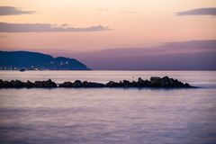 Strange Rocky Shoreline Sunset. Strange looking set of rocks nearby the shoreline during sunset with beautiful colors in Marmara sea of the country Turkey. Early Stock Images