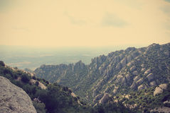 Strange rugged landscape of the Montserrat mountain; retro Royalty Free Stock Photo