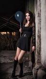 Strange scared girl holding black balloon Stock Images