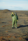 Strange scientist in overalls and gas masks Stock Photos