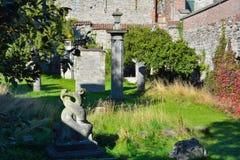 Strange sculptures in a mediaeval garden. Monastery Royalty Free Stock Photos