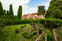 Strange shapes of cypress trees in park, Sirmione stock image