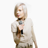 Strange slim blonde girl sing karaoke. With microphone Stock Images