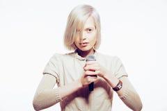 Strange slim blonde girl sing karaoke. With microphone Royalty Free Stock Photo