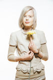 Strange slim blonde girl with a yellow flower Stock Image