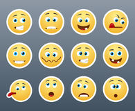 Strange smilies. Beautiful and funny yellow smiley in a small set of Royalty Free Stock Photography