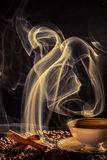 Strange smoke rising over the roasted coffee Stock Photos