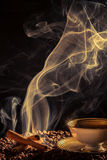 Strange smoke rising over the roasted coffee Stock Photography