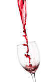 Strange splash od red wine in to glass Stock Photo