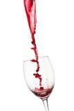 Strange splash od red wine in to glass. On white background Stock Photo