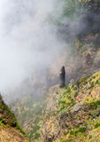 Strange stone in the mountains of Madeira among fog and clouds Royalty Free Stock Image