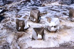 Strange triangle-shaped concrete structure in boiling river water Royalty Free Stock Image