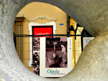 Strange view. Photo took by hole in statue. Building in the background Royalty Free Stock Photo
