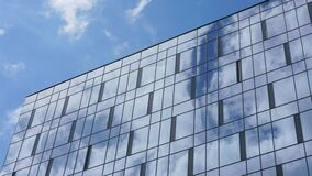 Clouds float in blue sky and across glass facade windows