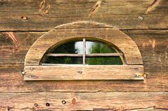 Strange window in wooden wall Royalty Free Stock Image