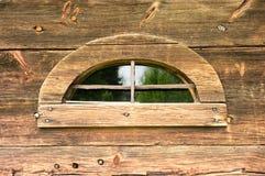 Strange window in wooden wall Royalty Free Stock Image