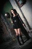 Strange young girl holding black balloon Royalty Free Stock Photography