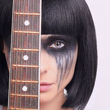 Strange young woman with guitar Royalty Free Stock Images