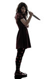 Strange young woman killer holding  bloody knife silhouette. One caucasian strange young woman killer holding  bloody knife in silhouette white background Royalty Free Stock Image