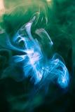 Strangely shaped puff of smoke. On green Stock Image