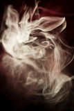 Strangely shaped puff of smoke Stock Images