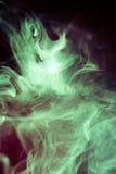 Strangely shaped puff of smoke. Strangely shaped green puff of smoke on black Royalty Free Stock Images