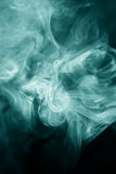 Strangely shaped puff of smoke. On black Stock Photo