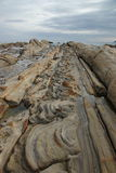 Strangely shaped rocks park called Tatsukushi. Tatsukushi is the abrasion platform where sandstones eroded by the sea and wind in Kochi, Japan Royalty Free Stock Photos
