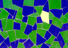 Stranger. One yellow tile peace between green and blue ones royalty free stock photography