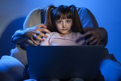 Stranger reaching little child with laptop. Cyber danger. Stranger reaching little child with laptop on color background. Cyber danger royalty free stock photos