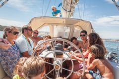 Strangers on boat Tour in Mediterranean Sea. MEDITERRANEAN SEA, SARDINIA/ITALY - AUGUST 13, 2013 - Strangers enjoy a summer, sailboat tour of the local islands Stock Photography