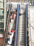Strangers on elevator. Group of strangers using external elevator going up Stock Image