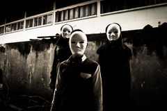 Strangers. Group of young people in halloween concept and book cover ideas Royalty Free Stock Photography